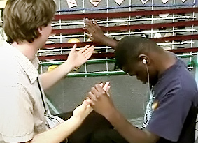 Teacher and student who is deafblind examining monthly calendar