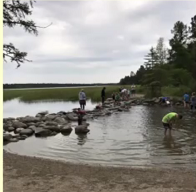 Picture showing people wading in the headwaters of the Mississippi River.