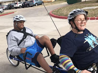 A young man who is deafblind share the joy of riding a tandem bike with his teacher.
