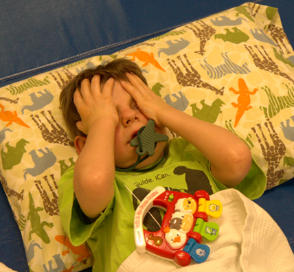 A young boy takes a time out before going to the next activity when he becomes distressed.