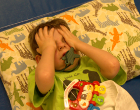 A young boy takes a time out when he becomes distressed.
